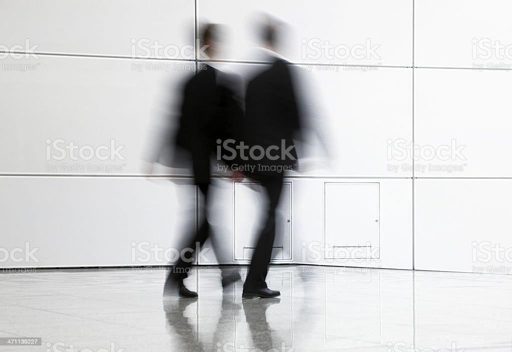 Two businessmen walking royalty-free stock photo