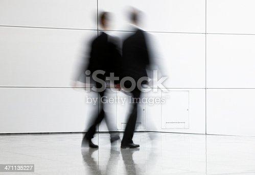 istock Two businessmen walking 471135227