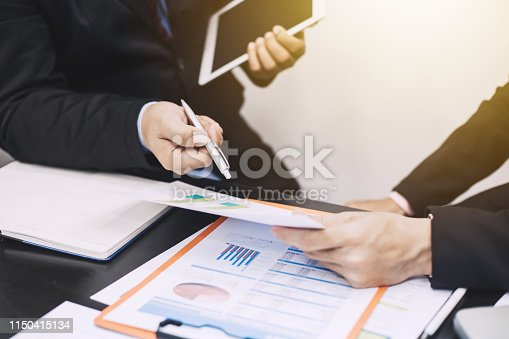 istock Two businessmen who are analyzing marketing income. Finance and Investment. 1150415134