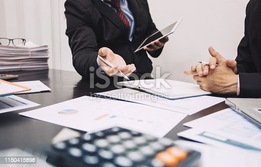 istock Two businessmen who are analyzing marketing income. Finance and Investment. 1150415898