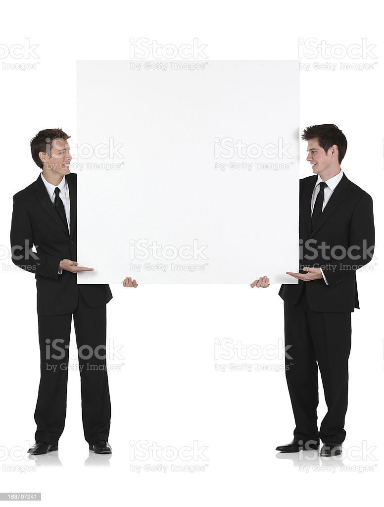 Two businessmen with a placard royalty-free stock photo