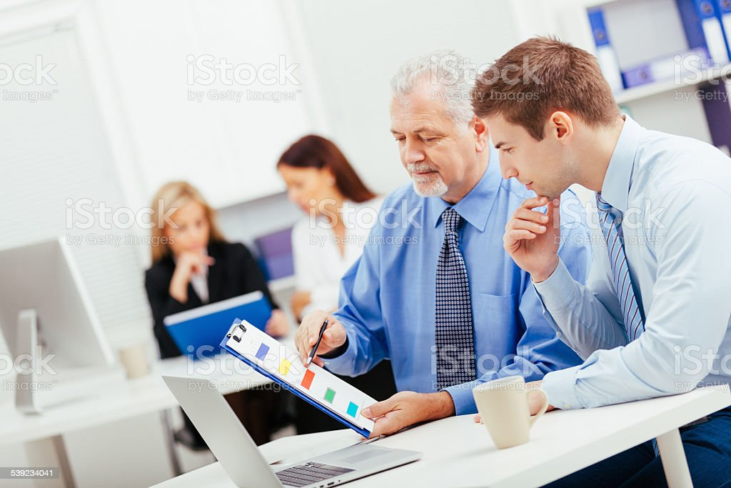 Two businessmen working together analyzing data royalty-free stock photo