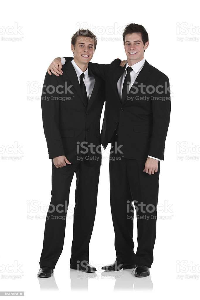 Two Businessmern standing with their arm around stock photo