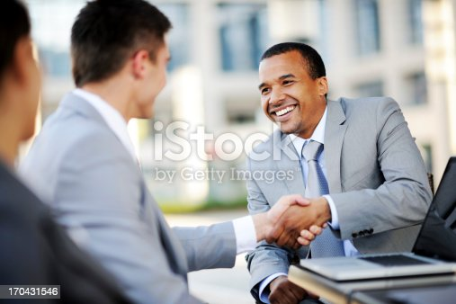 istock Two businesspartners making a business deal. 170431546