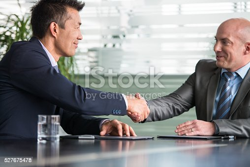 istock Two Businesspartners Making A Business Deal 527675478