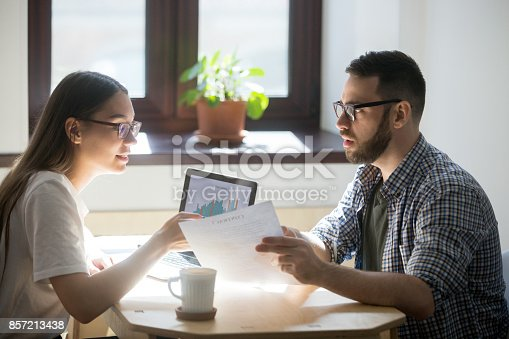 863128060istockphoto Two businesspeople discussing details of a contract. 857213438