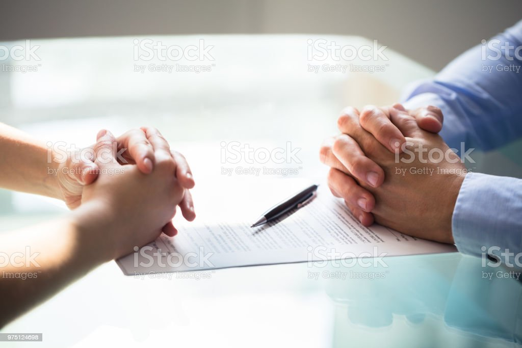 Two Businesspeople Hand With Document stock photo