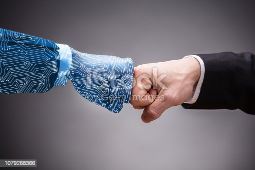 1050855372 istock photo Two Businesspeople Making Fist Bump 1079268366