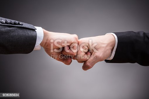 istock Two Businesspeople Making Fist Bump 928085634