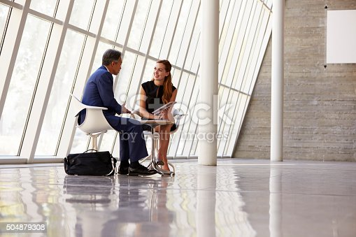 504879112istockphoto Two Businesspeople Meeting In Reception Of Modern Office 504879308