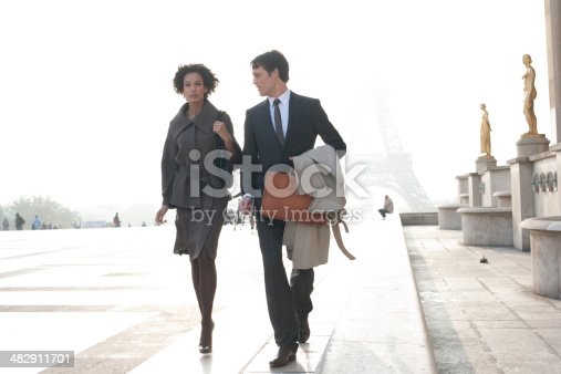 istock Two businesspeople outdoors walking by building near Eiffel Tower 482911701