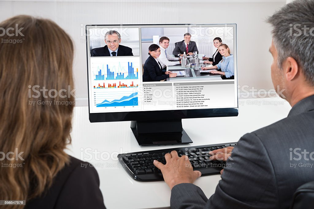 Two Businesspeople Participating In Video Conference photo libre de droits