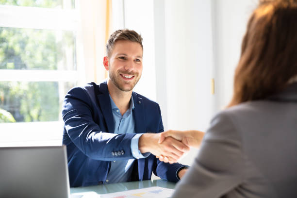 Two Businesspeople Shaking Hands Smiling Young Businessman Shaking Hands With His Partner job interview stock pictures, royalty-free photos & images
