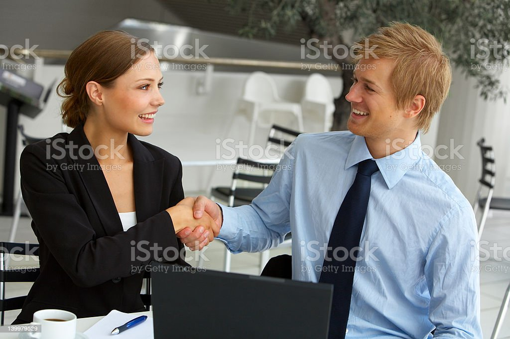 Two businesspeople shaking hands. royalty-free stock photo