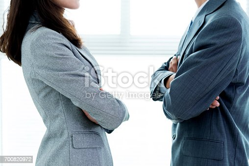 Two businesspeople standing face to face