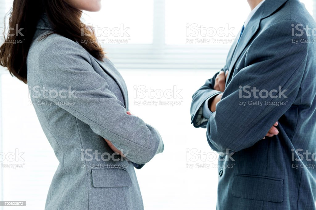 Two businesspeople standing face to face stock photo