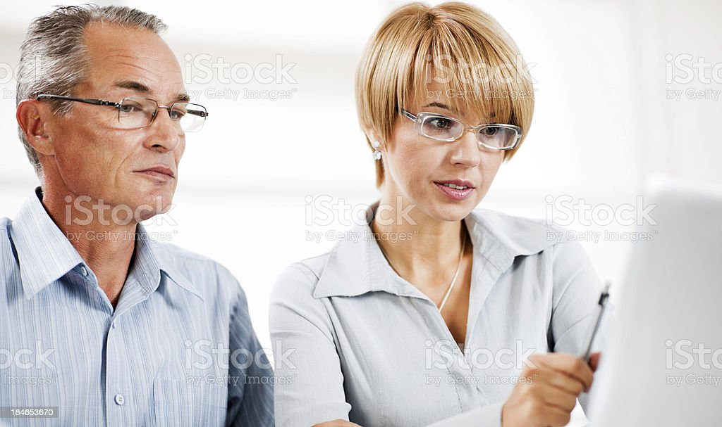 Two businesspeople working together on a computer royalty-free stock photo