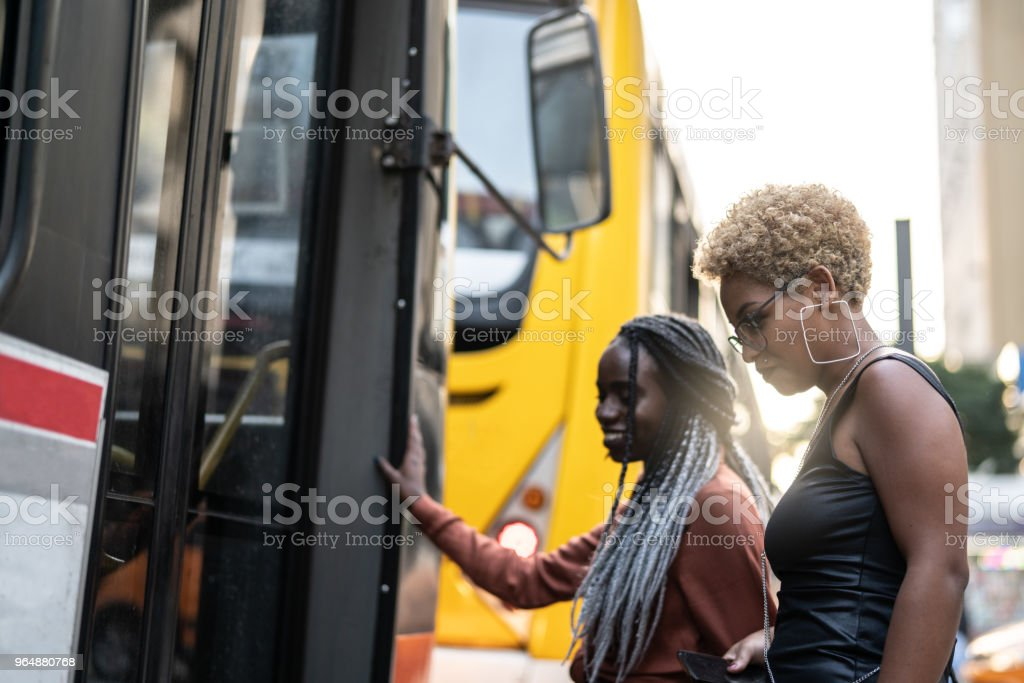 Two Businesswoman getting on the bus, Brazil royalty-free stock photo