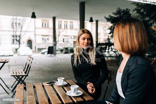 Two businesswoman having a coffee break.
