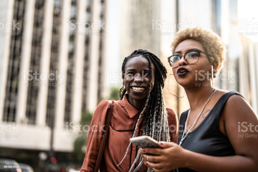 Two Businesswoman Waiting for the Transport royalty-free stock photo