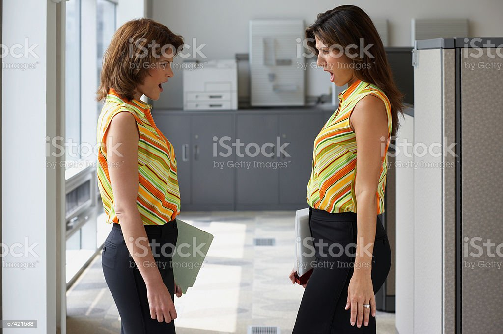 Two businesswoman wearing matching outfits stock photo