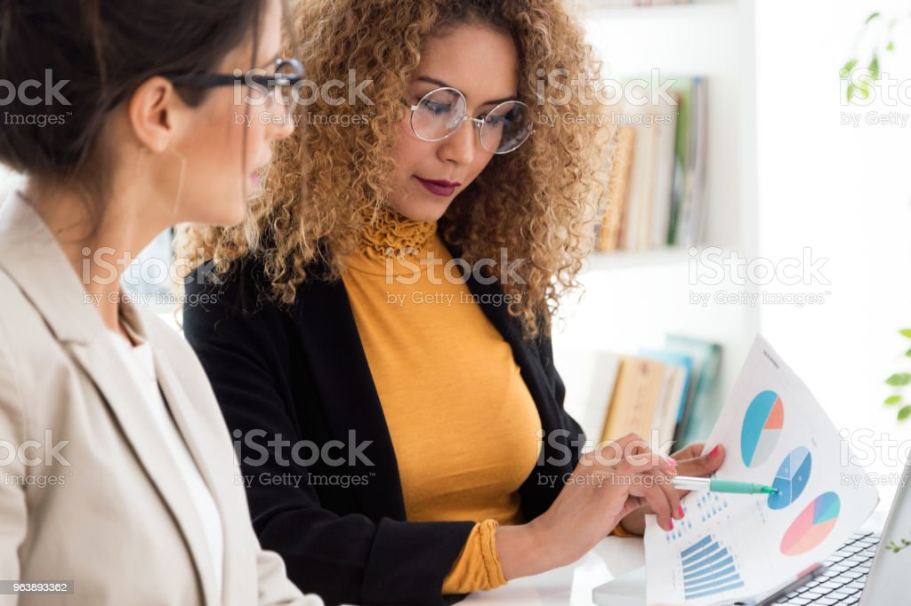 Two businesswoman working in her office. - Royalty-free Achievement Stock Photo