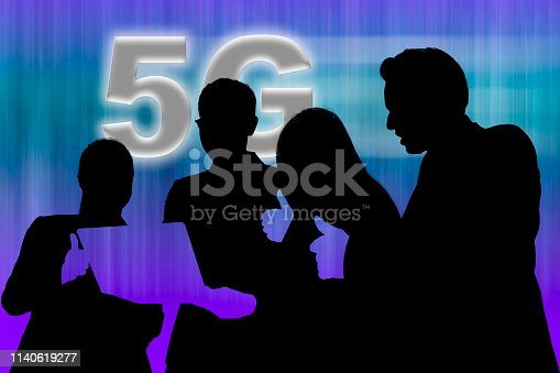 1141355850 istock photo Two businesswomen and two businessmen looking at notebook computer and raising thumb up for 5G network result 1140619277