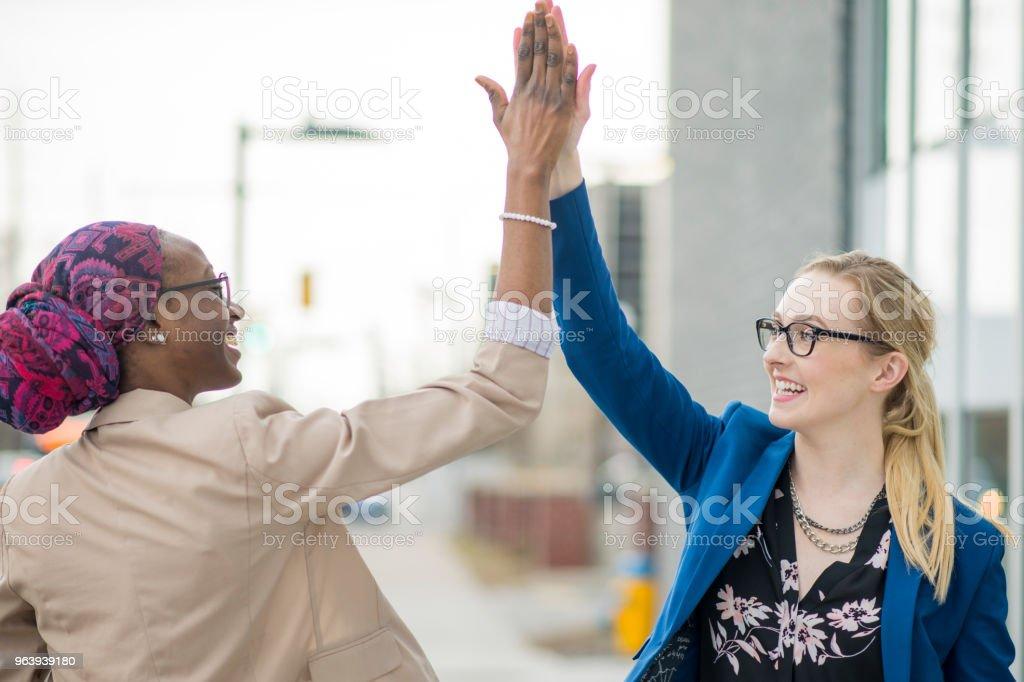 Sharing Success - Royalty-free 20-29 Years Stock Photo