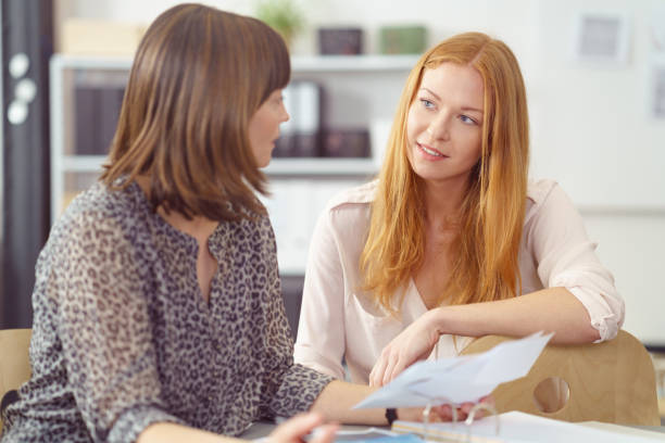 Two businesswomen in a serious discussion stock photo