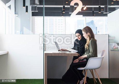 istock Two businesswomen in office cubicle, Dubai, UAE 514152966