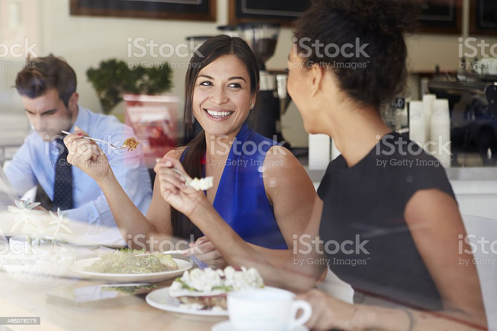 Two Businesswomen Meeting For Lunch In Coffee Shop stock photo