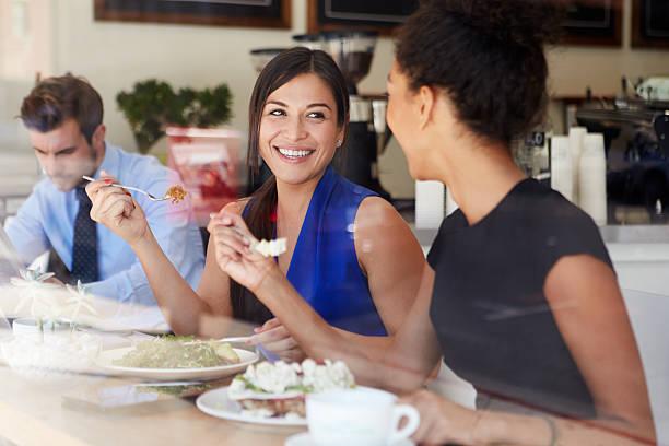 two businesswomen meeting for lunch in coffee shop - lunchrast bildbanksfoton och bilder