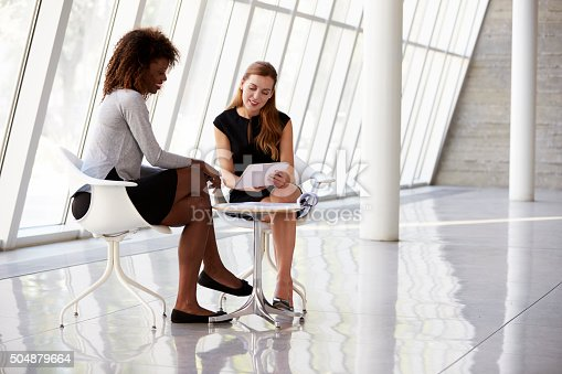 504879112istockphoto Two Businesswomen Meeting In Reception Of Modern Office 504879664