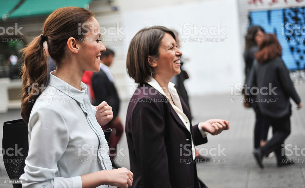 Two Businesswomen Walking On A Street royalty-free stock photo