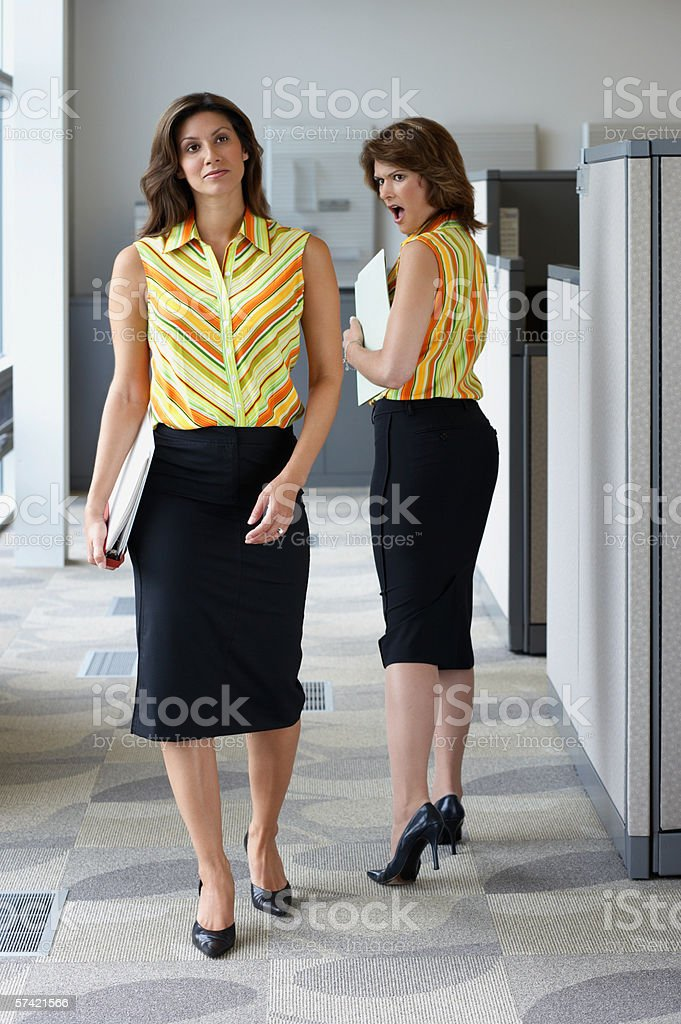 Two businesswomen wearing matching outfits stock photo