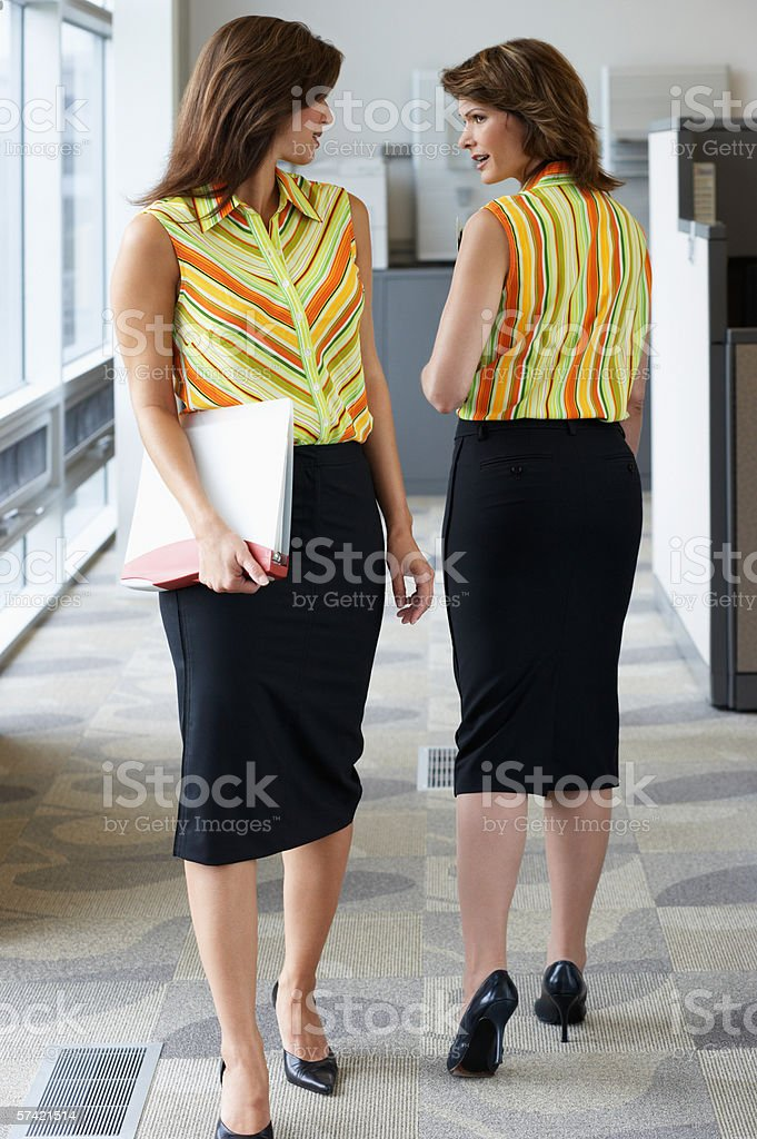 Two businesswomen wearing the same outfit stock photo