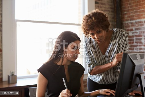 istock Two Businesswomen Working On Computer In Office 637152194