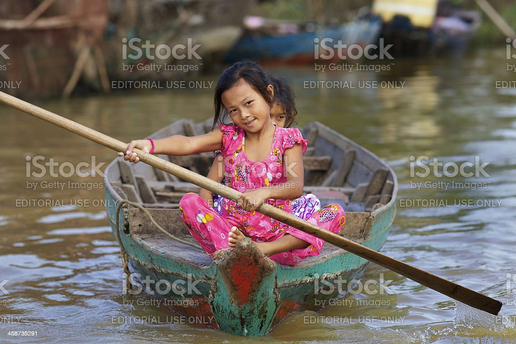 Two Cambodian Children in Boat royalty-free stock photo