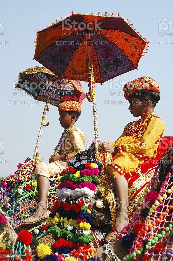 Two cameleers are taking part at camel decoration competition, Pushkar royalty-free stock photo