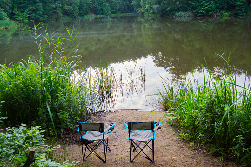 two camping chairs and lake view