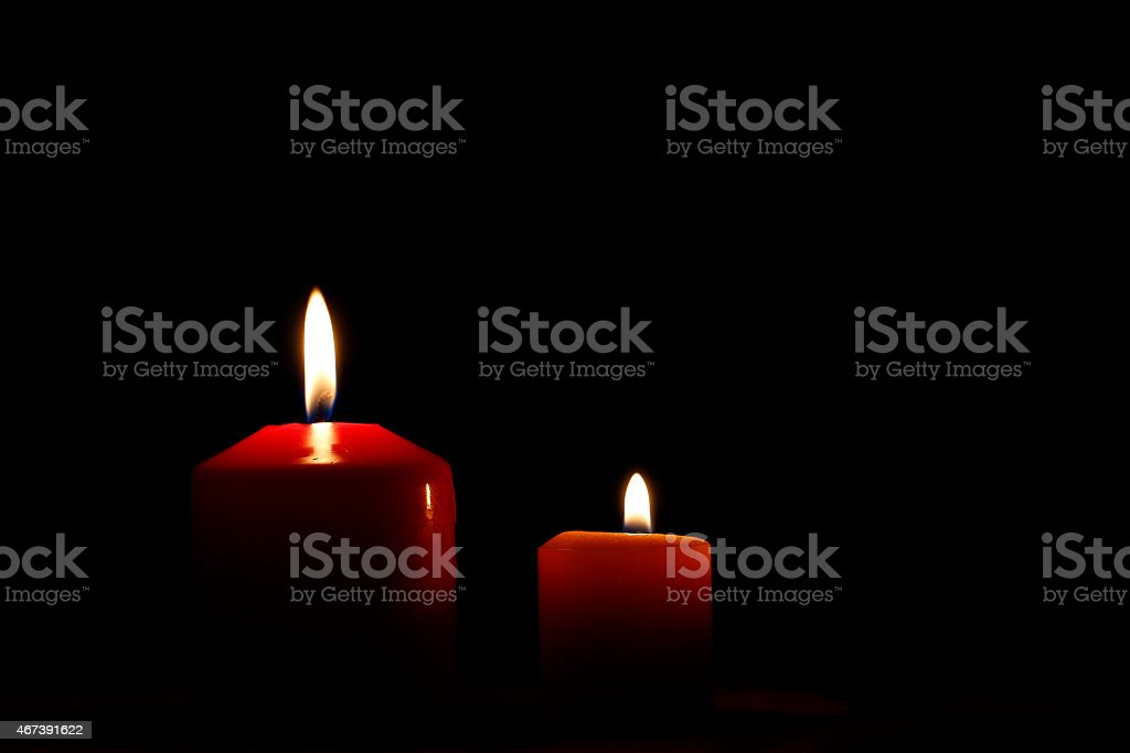Two candle flames stock photo