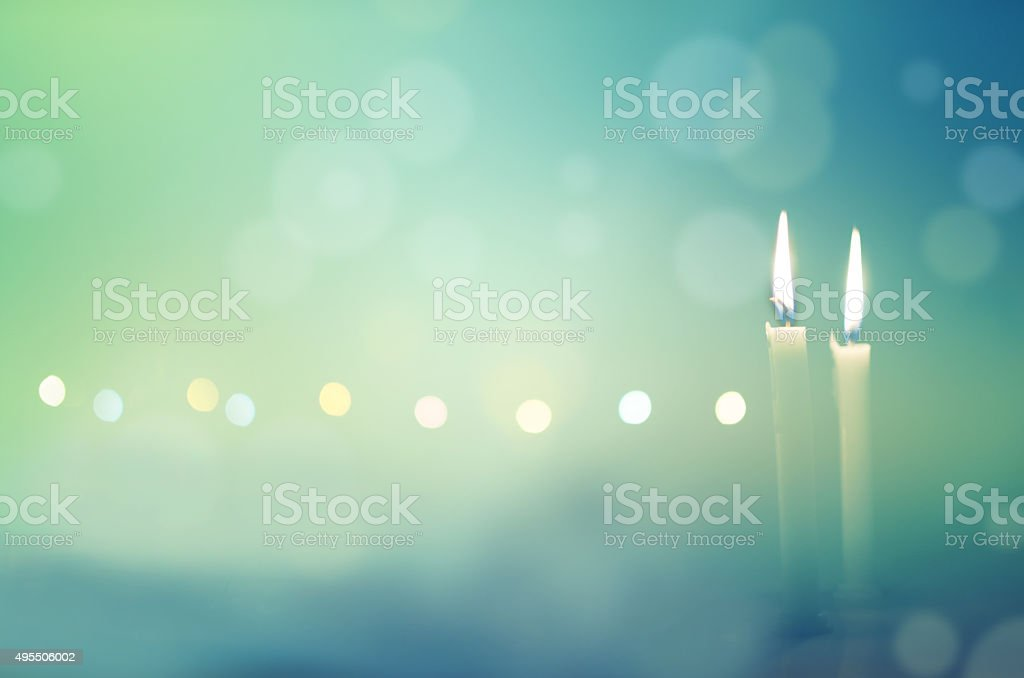 Two candles in dark night stock photo