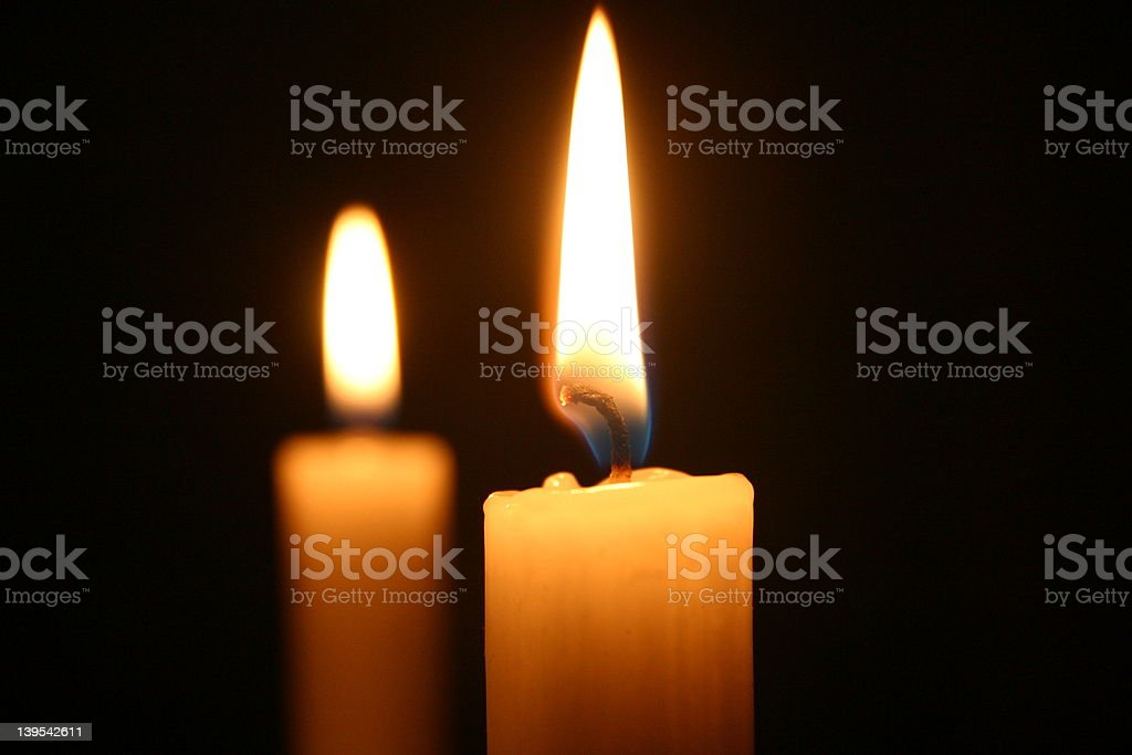 Two candles Two candles at christmas time Burning Stock Photo