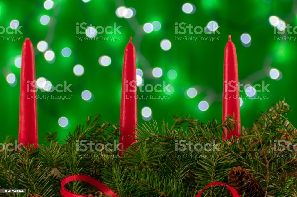 A Christmas Arrangement.Two Candles Within A Christmas Arrangement Stock Photo Download Image Now