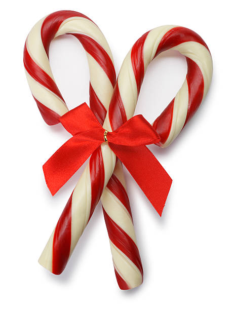 Two Candy Canes Two candy canes on white with soft shadow. candy cane stock pictures, royalty-free photos & images