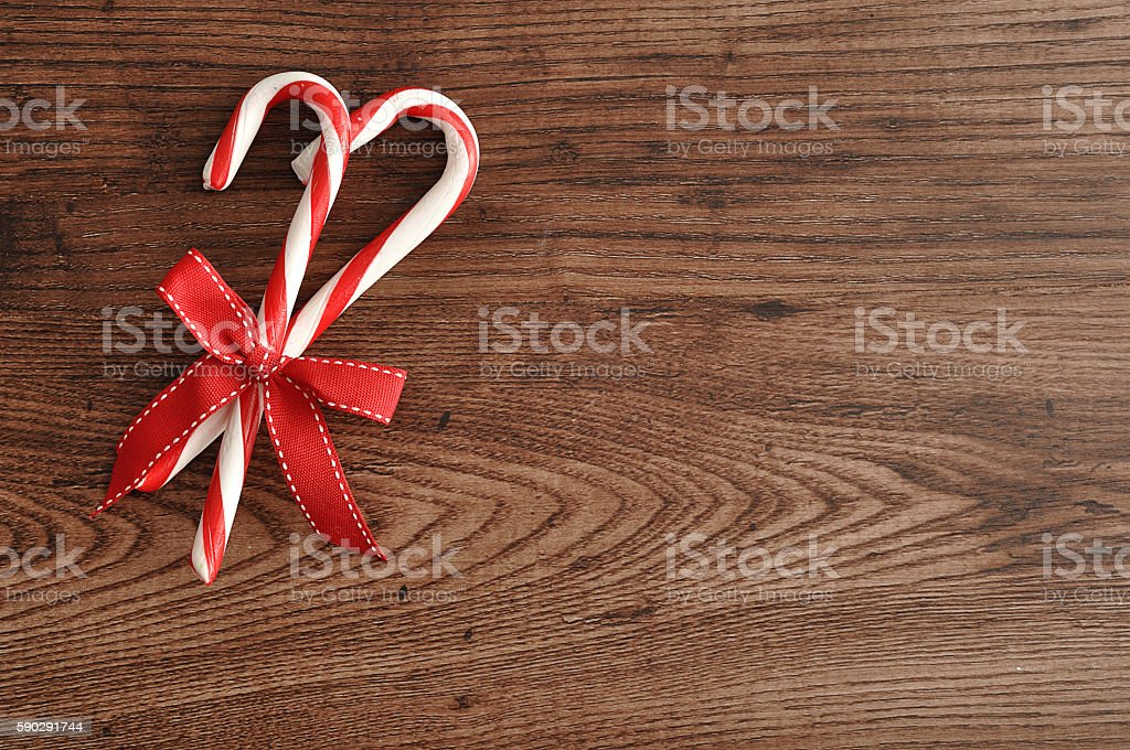 Two candy canes with a red bow royaltyfri bildbanksbilder