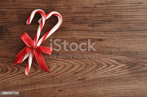 Two Candy Canes With A Red Bow-foton och fler bilder på December