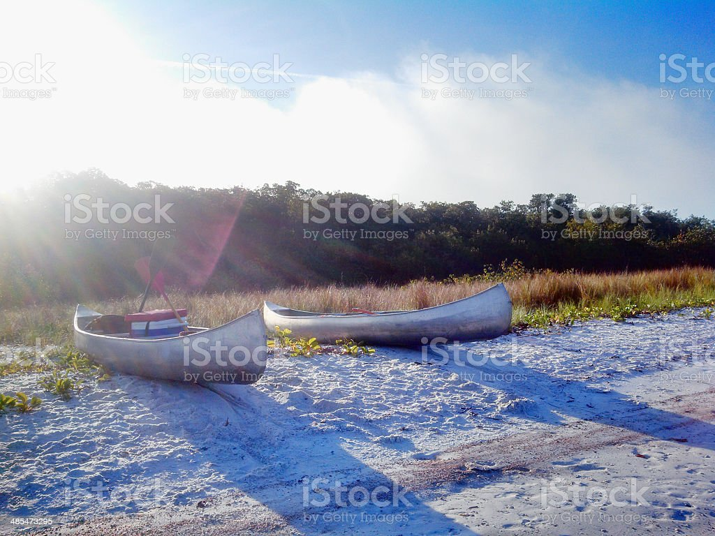 Two Canoes Beached on an Island stock photo