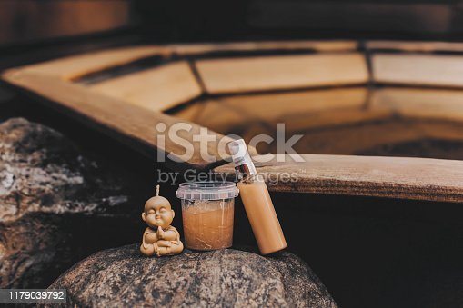 1042453716 istock photo Two cans of cosmetics and candle on a wooden pool background. 1179039792
