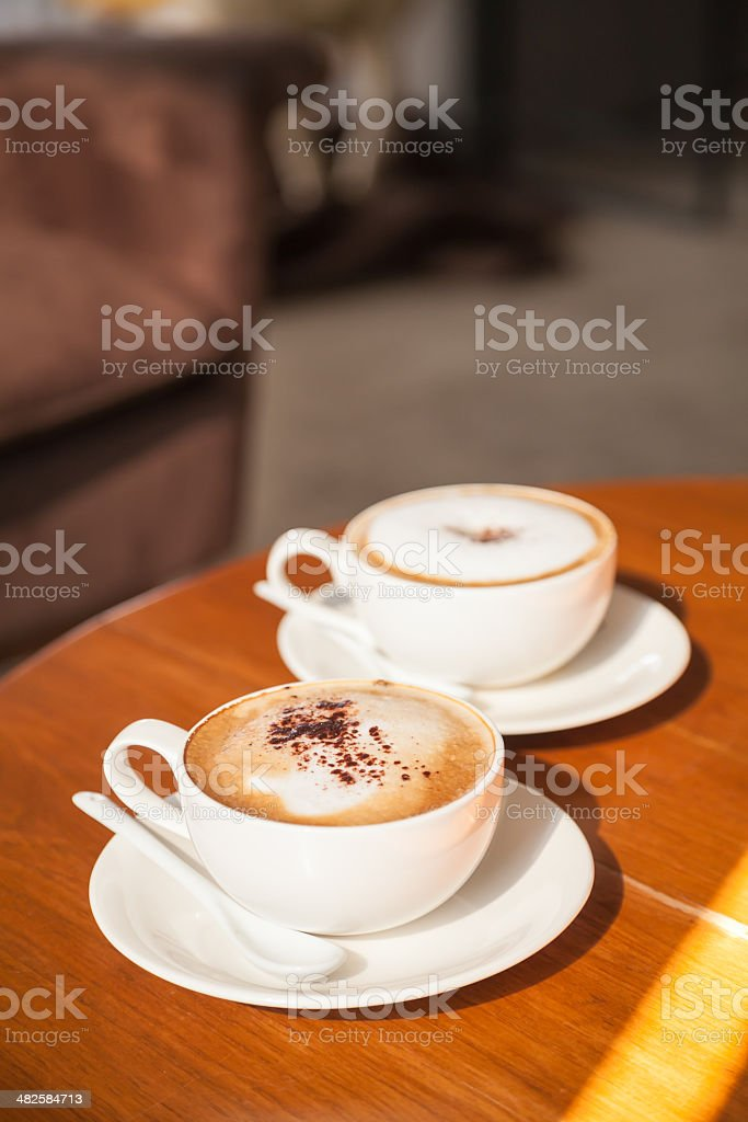 Two Cappuccino Coffees royalty-free stock photo